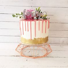 Pink drip birthday cake with hand painted gold lustre detail and fresh flowers on geometric stand by Blossom & Crumb