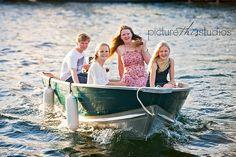 Love photographing this family. This year the kids jumped in their boat and tried to escape.... but the photographer won!