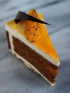 It's been really difficult to find a nice example featuring chocolate and orange.  Most end up looking like loaf cakes.  The layers on this are beautiful, so when I try to make a chocolate/orange cake, I will aim for this.  I would want to try it with blood orange as well.  [From Patisserie Deffert via Mimora]