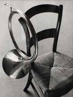 André Kertész - Chair with french horn, 1927. S)