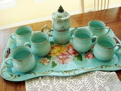 Aqua colored vintage tea set with teapot, creamer, sugar and teacups.
