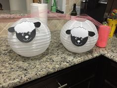Lamb lanterns - white lanterns (party city), printed lamb picture, and roll of tool to hang them.