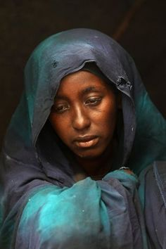 Safia Adem mourns the death of her son Hamza Ali Faysal, 3, in a camp of displaced Somalis within the rubble of the Cathedral of Mogadishu on August 13, 2011 in #Mogadishu, #Somalia.  (Photo by John Moore/Getty Images)