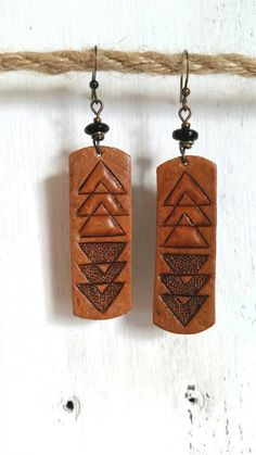 Check out this item in my Etsy shop https://www.etsy.com/listing/493975361/hand-carved-leather-earrings-with-tribal