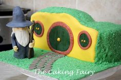 Hobbit House Cake by The Caking Fairy. First time I attempted making a model with fondant, was quite chuffed with the result :-) Making A Model, House Cake, Celebration Cakes, The Hobbit, Minions, Fondant, Fairy, Kids Rugs, How To Make