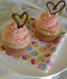 Fresh Strawberry cupcakes filled with chocolate mousse and topped with a fresh strawberry swiss meringue buttercream