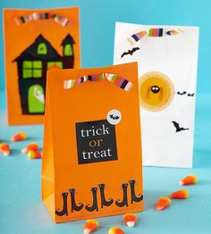 These Halloween treat containers are easy to put together -- embellish a few crafts store paper bags with Halloween-theme stickers, ribbon, and patterned-paper cutouts. Done!