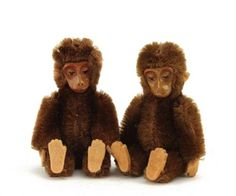 Two Schuco miniature monkeys, 1950s, with brown mohair, painted metal face, jointed metal framed bodies and felt hands - 3¼in (8.5cm) high