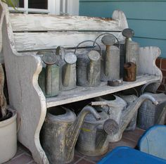 These old watering cans have been give a new lease of life as an al fresco style statement!