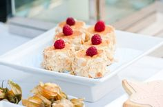 Flaked almond gives the impression of crushed sea shells and these mini cakes are topped with fresh raspberries for a dash of color.