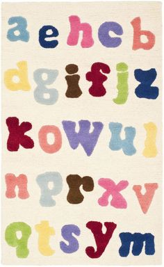 The Safavieh Kids Alphabet Rug will make a fun and stylish addition to your child's bedroom or playroom. This rug is hand-tufted of wool and cotton for a plush feel, and it features a colorful alphabet pattern over an ivory background. Childrens Alphabet, Alphabet For Kids, Alphabet Soup, Clearance Rugs, Hand Tufted Rugs, Cool Rugs, Wool Area Rugs, 6 Years, Rug Size