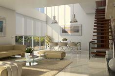 Imagen del Interior de una de las viviendas de Conil de la Frontera (Cádiz). El comedor a doble altura y sus grandes ventanales abiertos hacia la piscina le confieren una gran espacialidad al interior de la vivienda.
