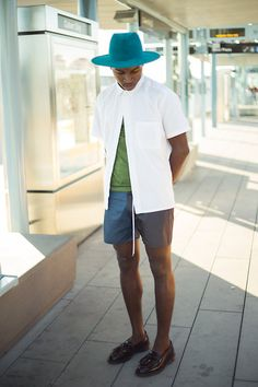 White Shirt, Two Toned Shorts, Shade And Slouch Teal Fedora, Dr. Martens