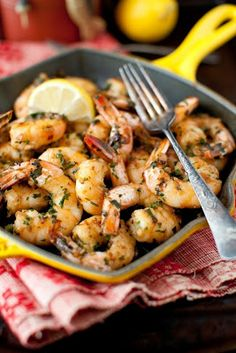 Sauteed shrimp with garlic, wine, olive oil, paprika, and lemon juice. Yum!