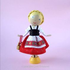 When Heidi went to live with her grandfather high in the Swiss Alps she found happiness again. Most of all she loved to walk in the Alpine Clothes Pin Ornaments, Clothespin Art, Wood Peg Dolls, Clothes Pegs, Thinking Day, Sewing Dolls, Little Doll, Fairy Dolls, Doll Crafts