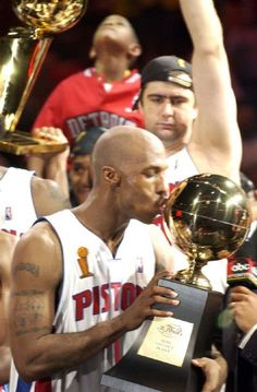 Chauncey Billups kisses the trophy after the Pistons won the NBA Championship  in  Game 5 against the  Los Angeles Lakers, June 15, 2004, at The Palace of Auburn Hills. (The Detroit News/ Clarence Tabb, Jr.)