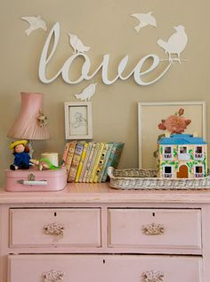 love sign in nursery | pink dresser + white animal wall decals