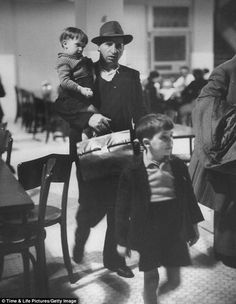 Important cargo: This man and his two children were some of the 12 million to pass through Ellis Island