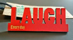 Wooden Inspirational 'Laugh Everyday' Badge in red, orange, white, blue and black. Handmade jewellery, lasercut from upcycled wood. by BoughtoBeauty on Etsy