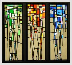 A very simple yet very effective stained glass design. These panels were produced in antique glass and include hand painted and kiln fired detail, etching and leading.