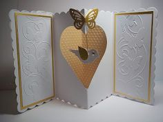 Meiflower Design Team - cut out heart with bird in empty space