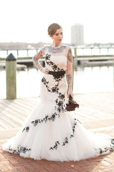 Love how the tattoos work into the dress in an artistic way