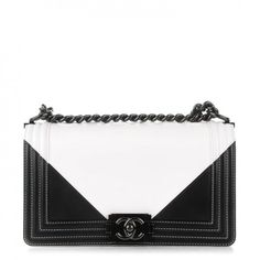 This is an authentic CHANEL Calfskin Medium Bicolor Boy Flap in Black and White. This bold shoulder bag is crafted of black and white calfskin leather in a graphic pattern and framed with embroidered leather.