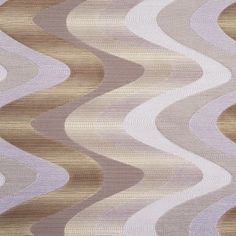 This is a synthetic blend woven with a soft zig zag pattern in ivory, cashmere, and dark beige. Semi-lustrous, good for drapery or Upholstery.