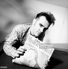 British singer Morrissey holds a 1952 copy of 'The New Musical Express' magazine to celebrate the 40th anniversary of the publication, 24th March 1992. The magazine cover features a tribute to Dame Vera Lynn. In August of 1992, the NME published an article which explored accusations of racism against Morrissey.