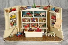 Petite German miniature toy store with wooden Erzebirge toys. $900/1400