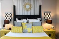 Accent pillows, gray and yellow scheme, curtain behind bed