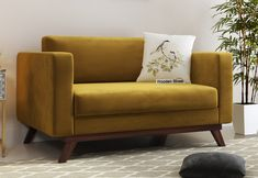 Buy loveseat online like Casper 2 seater sofa from Wooden Street. This love seat sofa withstands tapered legs and boxy silhouette to inspire mid-century modern design. #loveseats #loveseatsofa #fabricsofa #2seatersofa