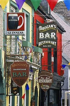 Pub signs, O'Connell Street, Ennis Town, County Clare, Munster, Republic of Ireland, Europe