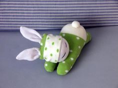 Lovely and very soft bunny made of white and light green dotted socks. This adorable sleeping bunny is a perfect gift for everyone or sweet decoration in your home. Hand crafted by me from brand new socks, sewing machine and hand sewn elements. Stuffed with high quality polyester filling. I do not use buttons to be suitable for children. ALL NEW MATERIALS! I use socks of at least 85% cotton. This bunny rabbit measures approximately 8 (20 cm) long from the top of the head to the bottom of…