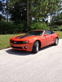 $31,000 - 2013 CHEVY CAMARO CONVERTIBLE 1-LT 6 SPEED AUTO  Like new condition. Adult owned. mi. 6 speed automatic transmission. 3.6 Liter sidi V6 engine. Inferno orange metallic. Mint, New condition. For more details please visit: http://goo.gl/TKtgcR