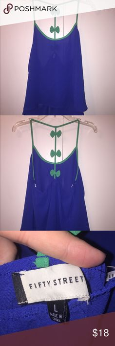 Blue summer top Adorable blue summer top with bow details on back. Racer back straps. fifty street Tops Blouses