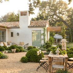 Backyard oasis of Patina Farm, a masterfully built serene modern farmhouse with European charm by Giannetti Home in Ojai, California.
