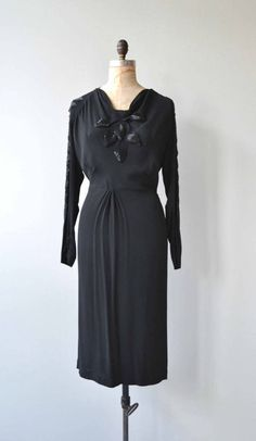 Vintage 1930s black rayon dress with amazing diamond cutout upper back and sleeves trimmed with black bugle beads, bias construction, black bugle beaded front detail, fitted waist and metal side zipper. --- M E A S U R E M E N T S --- fits like: large bust: 39 waist: 33 hip: 40 length: 44 brand/maker: n/a condition: excellent to ensure a good fit, please read the sizing guide: http://www.etsy.com/shop/DearGolden/policy ✩ layaway is available for this item...