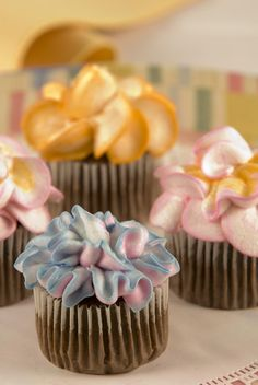 """Buttercream Flower Cupcakes. Frosting your cupcakes to look like dahlias, carnations, or any other favorite flower is easy when you use a pastry bag and a special """"petal"""" or """"rose"""" piping tip that you can find at most kitchen and craft stores. To create a two-tone effect that mimics the looks of flowers in your garden, place two complementary colored frostings side by side in a piping bag."""