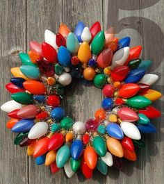 Vintage Christmas Light Wreath. What a great idea! I have so many of these from my parents. Couldn't bear to throw them away, but I didn't know what to do with them #christmaslightsideas