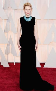 Cate Blanchett in a black column gown by Maison Margiela Couture by John Galliano with a statement turquoise necklace.