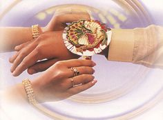 Festivals of India - Raksha Bandhan.  Raksha literally means 'protective' and bandhan means 'binding'. Raksha Bandhan is the festival of tying the protective amulet and celebrates the love between a brother and sister.