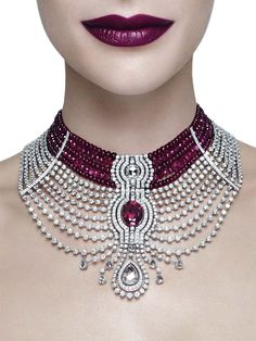 The star of Cartier's Reine Makéda necklace, part of the Royal collection, created for the Biennale des Antiquaires, is a 15ct oval-shaped ruby from Mozambique, with ruby beads and diamonds completing the elaborate choker-style necklace., HT