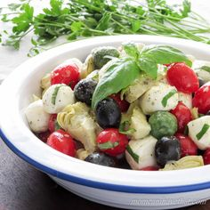 Perfect for gatherings, this attractive Caprese Salad with Olives & Marinated Artichoke Hearts is great as a side, lunch, or even as a light meatless meal.