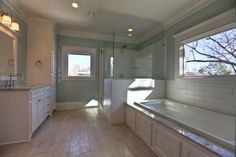 While the Buyer may select bathroom tile, paint and countertops, the homes designed by Modern Bungalow always make the best use of window light in the master bathroom.
