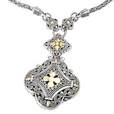 #750132 Filigree and cross design necklace in s/s w/ 18kt y/g accents.Contact us for more information @ http://carmouchejewelerslaplace.com/