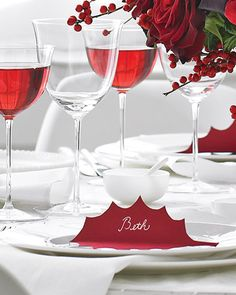 Red Holly-Leaf Place Cards- cutout, write name in silver ink, and fold in half. For gift tags too. white or kraft paper wrapping with big red fluffy bow or read and white bakers twine