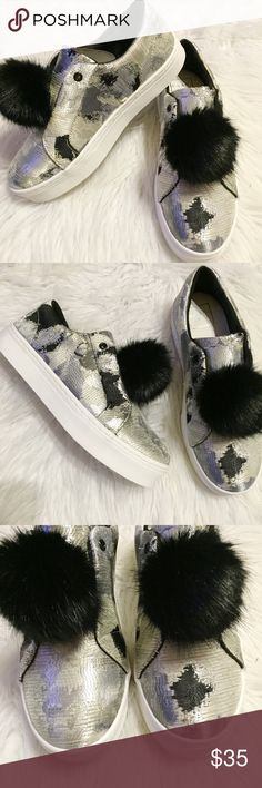 "🆕Silver/black metallic sheen Pom Pom shoes Adorable silver and black metallic sneakers with Pom Pom detail. Slip on, under 1"" heel, new in box. Price firm Shoes Sneakers"