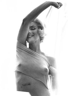 """Marilyn Monroe photo from """"The Last Sitting"""" a book and photo shoot by Bert Stern commissioned by Vogue in late June 1962 taking place over 3 days and just 6 weeks before she died. In the book, Stern recounted being enchanted by Monroe until a near-intimate encounter after the second day of shooting; he then realized that she was deeply troubled. Marilyn has a scar on her stomach from gallbladder surgery and shows her battle scar proudly in this photo."""