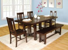 Here's a very solid dining set with bench. Table can be extended with a center leaf. Very good customer reviews (this is a popular dining set).